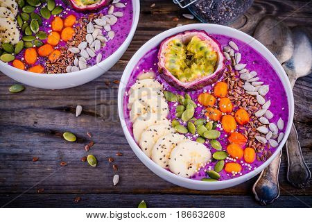 Blueberry Smoothies Bowl With Sea-buckthorn, Banana, Passion Fruit, Chia Seeds, Pumpkin Seeds, Sunfl