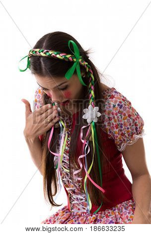 Brunette Brazilian girl wearing traditional costume for Junina Party