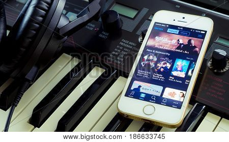 Bangkok Thailand - April 20 2017: Musician is using his iPhone to watch movie on iTunes store.