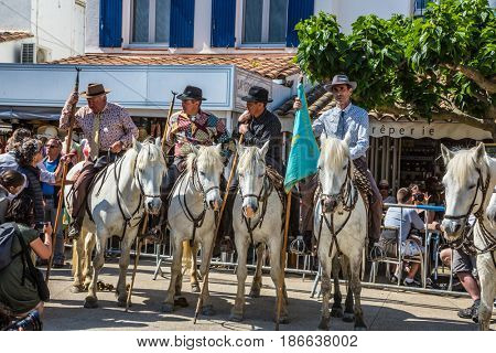 Sent-Mari-de-la-Mer, Provence, France - May 25, 2015. Guards on white horses before the start of the parade. World Festival of Gypsies. The concept of active and ethnographic tourism