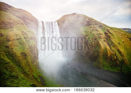 Famous Skogafoss waterfall in sunlight. Dramatic and gorgeous scene. Popular tourist attraction. Location Skoga river, highlands of Iceland, Europe. Unique place on earth. Explore the world's beauty.