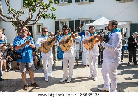 Saint-Marie-de-la-Mer, Provence, France - May 25, 2015. Annual World Festival of Gypsies. Group of musicians with guitars plays and sings in the town square