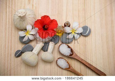 Spa treatment with spoon ,ball ,stones,oil , hibidcuson wooden board background