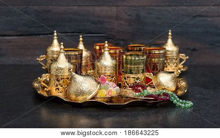Arabic tea coffee table with golden cups. Oriental hospitality. Ramadan kareem