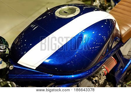 photo of bright gas tank of a motorcycle