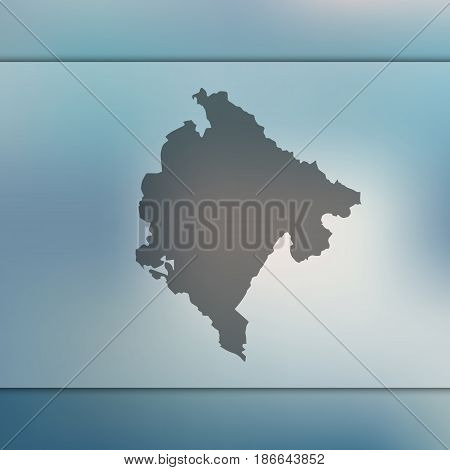 Montenegro map on blurred background. Silhouette of vector Montenegro map.