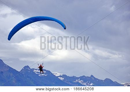 Tandem parachute jump in the background of sky