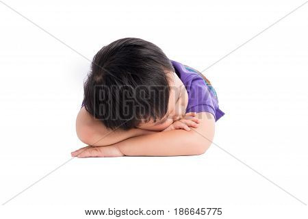 Tired kid boy lying on the ground with his face down