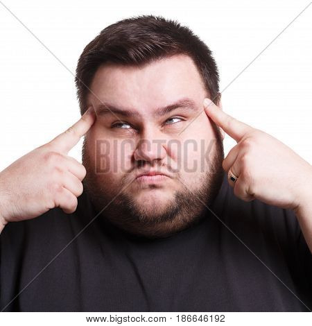 Overworking. Stressed fat man with fingers on temple suffering from headache, white isolated studio background
