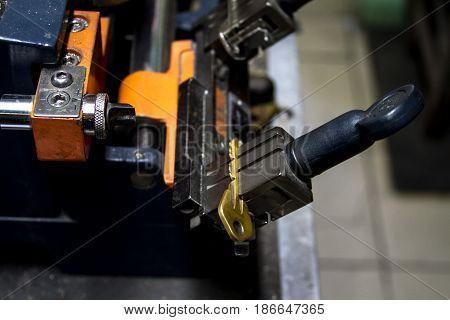 Machine production of duplicate metal keys. The key of the yellow metal.