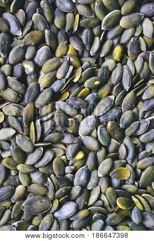 Background of peeled pumpkin seeds . .
