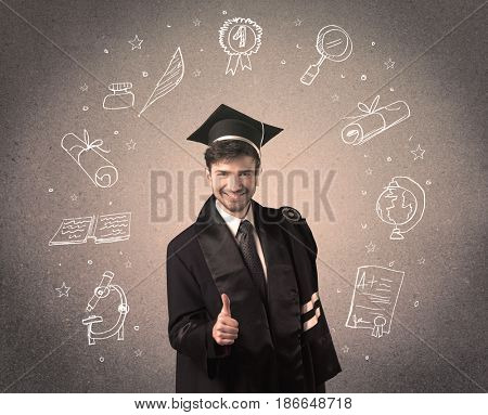 Happy graduate teenager with hand drawn school icons above his head