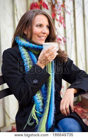 Beautiful smiling woman drinking coffee