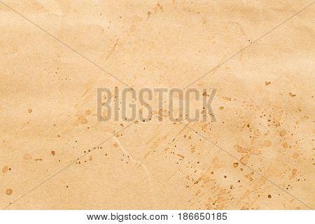 Old brown paper sheet abstract background,The surface is stained smudgy.