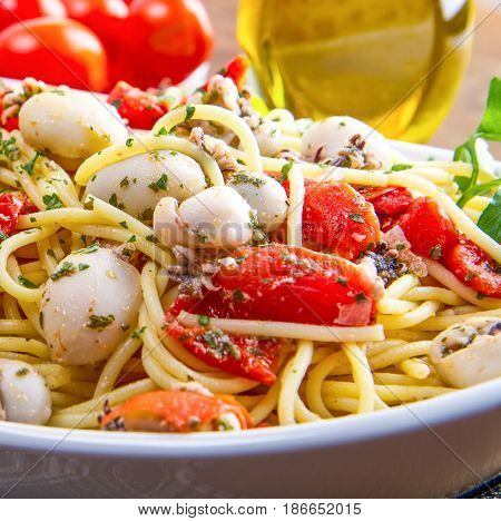 dish with spaghetti with cuttlefish and tomatoes
