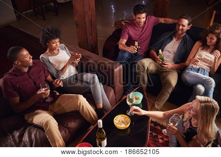 Young adults having a party at home, elevated view