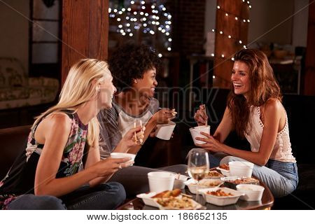 Three female friends hang out eating a Chinese take-away