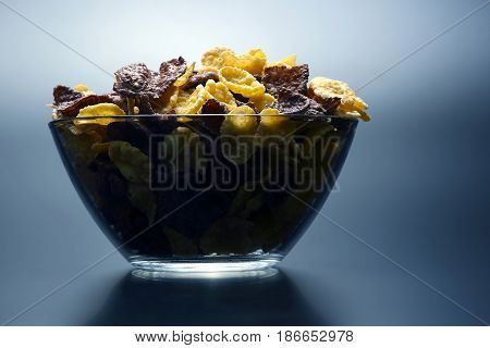 the a colored corn flakes in a bowl
