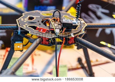 Microcircuits quadrocopter in disassembled form at the exhibition of robotics