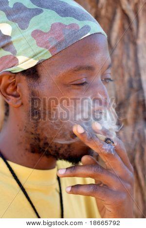 Rastafarian man smoking cannabis
