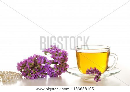 A bunch of badana and medicinal tea on a white background.