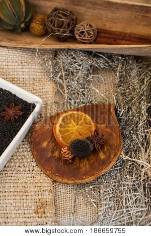 Top view of delicious dried slice orange anise and other dried fruits