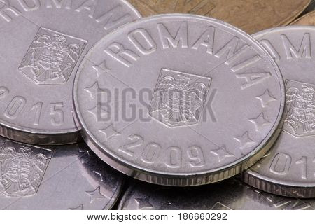 Detail of different Romania Leu coins on the table.
