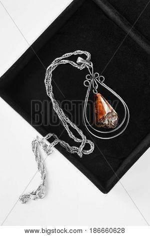 Vintage amber pendant on silver chain in black jewel box