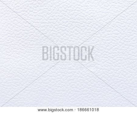Velvety soft textured and patterned white material as background.
