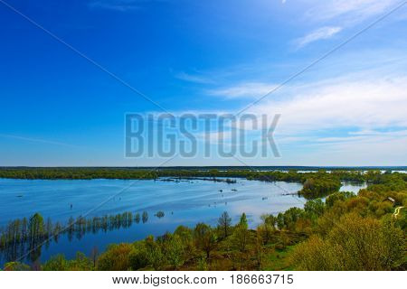 Beautiful spring landscape. Amazing view of the floods from the hill. Europe. Ukraine. Impressive blue sky with white clouds. Ukraine. Europe