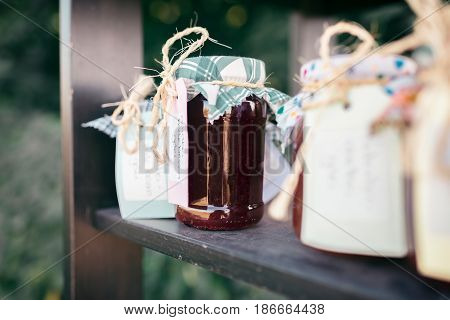 Private stall with home-made jams standing outdoors in summer.