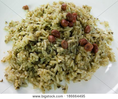 COLOR PHOTO OF RICE STIR WITH LAHPET (PICKLED TEA LEAVES) TOPPING WITH FRIED PEANUTS