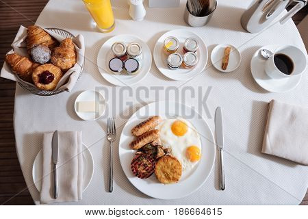 Continental breakfast. Top view of a dinner table with a food on it while being ready for breakfast