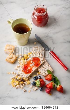 breakfast with coffee strawberry jam cookie and fruits