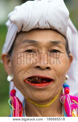 MAE KLANG LUANG, THAILAND - FEBRUARY 18, 2017 : A local Karen hilltribe woman is chewing betel plant in the Mae Klang Luang village near Chiang Mai, Thailand