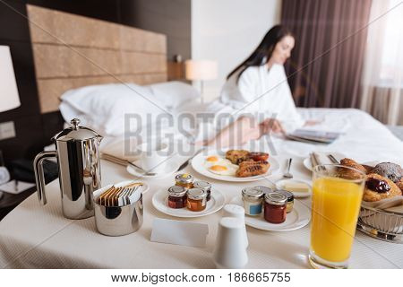Pleasant morning. Delicious breakfast standing on the table while being served for a hotel guest