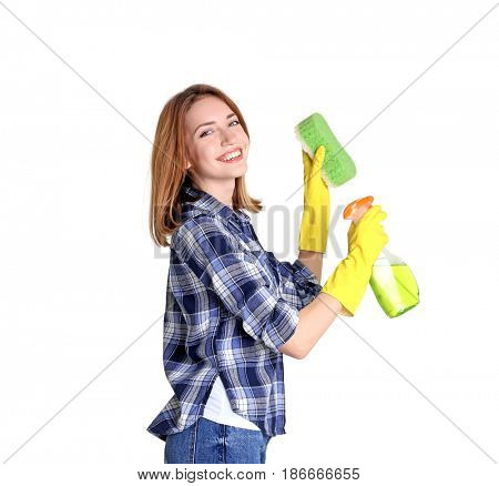Young woman holding sponge and cleanser spray on white background