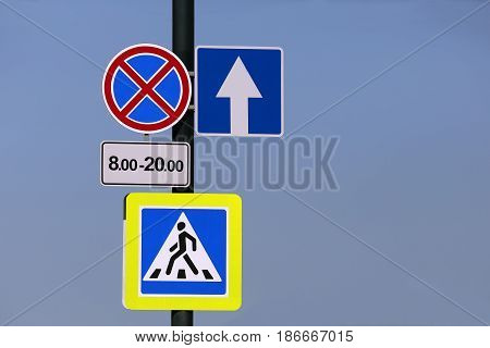 the a different road signs on a pole