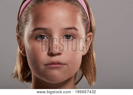 Nine year old girl looking to camera, close up head shot