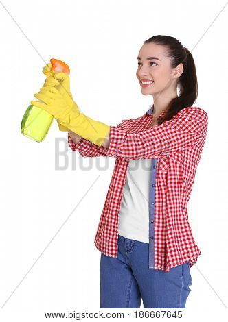 Beautiful young woman using cleanser spray on white background