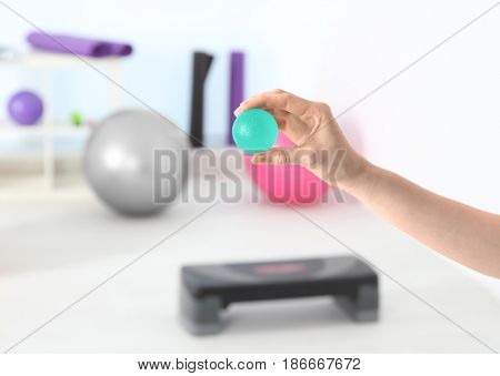 Hand of woman with stress ball in clinic