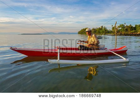 Labuan,Malaysia-May 13,2017:Traditional fisherman with fishing boat in the morning at Labuan,Malaysia.Traditional fishermen are the most numerous in marine capture fisheries,its operate relatively small fishing crafts fishing within 30 miles of the coast.