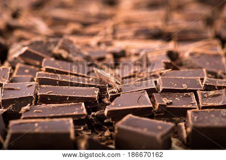 Stack Of Chocolate Slices With Mint Leaf. Dark Chocolate Over Wooden Background, Selective Focus
