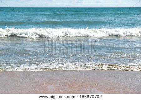 Front view Sea waves and sand beach