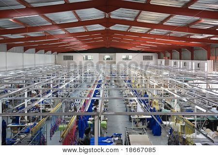 Industrial size textile factory in Africa, African workers on the production line