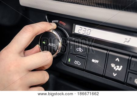 Hand Adjusting The Internal Temperature Of The Car