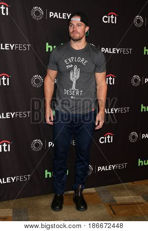 LOS ANGELES - MAR 18:  Stephen Amell at the 34th Annual PaleyFest Los Angeles - The CW at Dolby Theater on March 18, 2017 in Los Angeles, CA