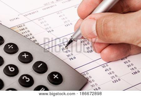Calculator data analysis analysis businessman closeup business analysis writing