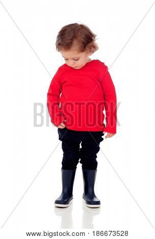 Shy baby with two years wearing red t-shirt isolated on a white background
