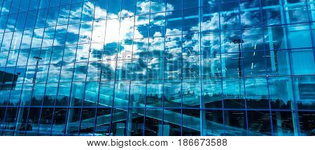 Skyscraper windows with reflection of the sky. Modern buildings